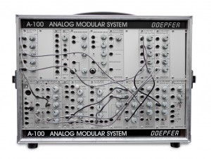 A modular synth. The oscillators, filters, envelopes, amplifiers and other gadgets are manually connected with patch chords. Each sound can have it's own synth architecture.